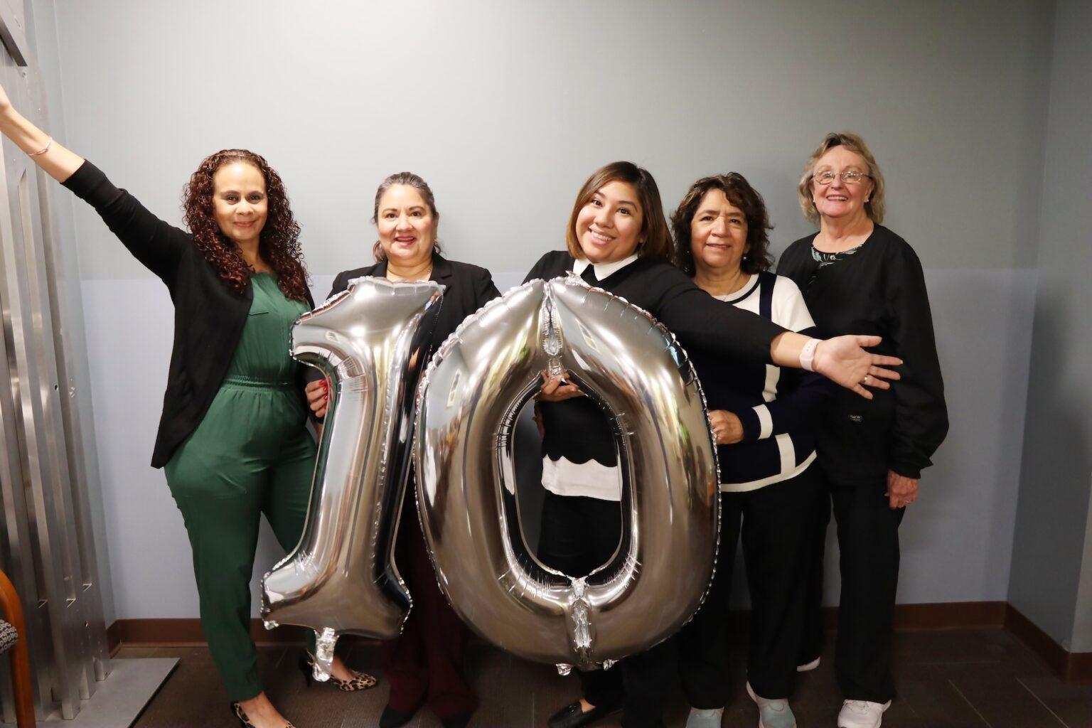 5 women holding up balloon 10